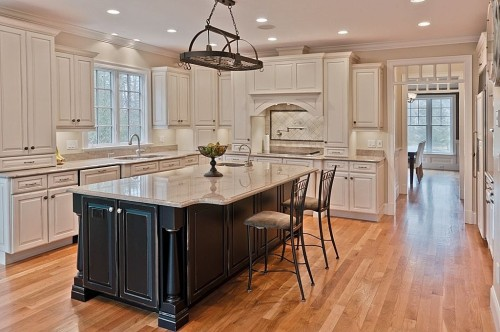 Clean, crisp, white kitchens with light granite and stone back splash