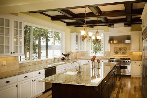 Traditional with light granite on light cabinets and a dark island