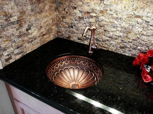 statement sink in stone countertop